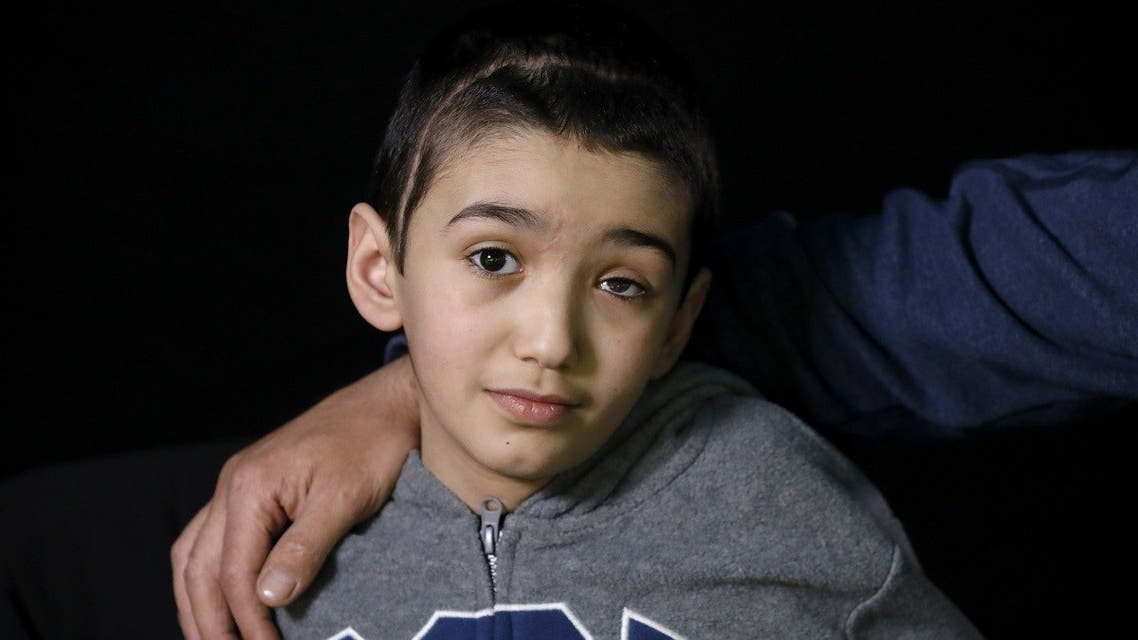 Malek Issa, 9, who lost his left eye in the ongoing conflict with Israel, poses during a photo session in Jerusalem on May 6, 2020. (Emmanuel Dunand/AFP)