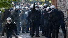 Dozens detained by Greek police at march in memory of slain teen