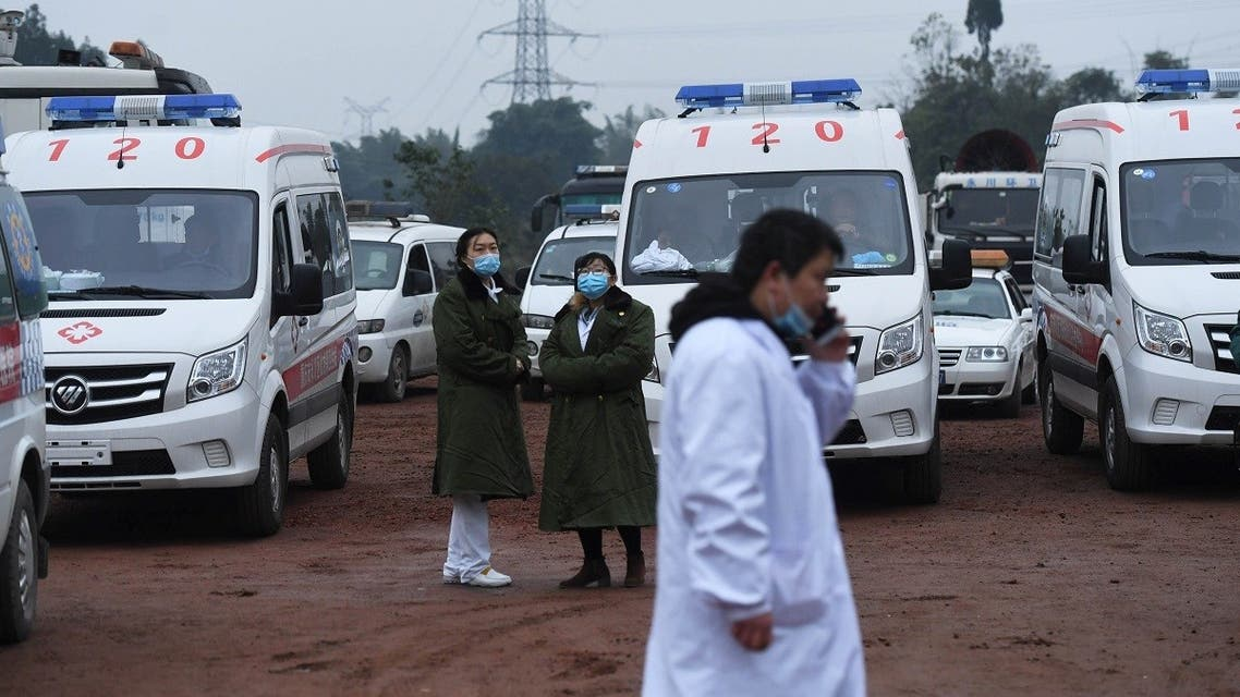 Rescue personnel wait beside parked ambulances outside the Diaoshuidong coal mine in southwestern China's Chongqing on December 5, 2020. (STR/AFP)
