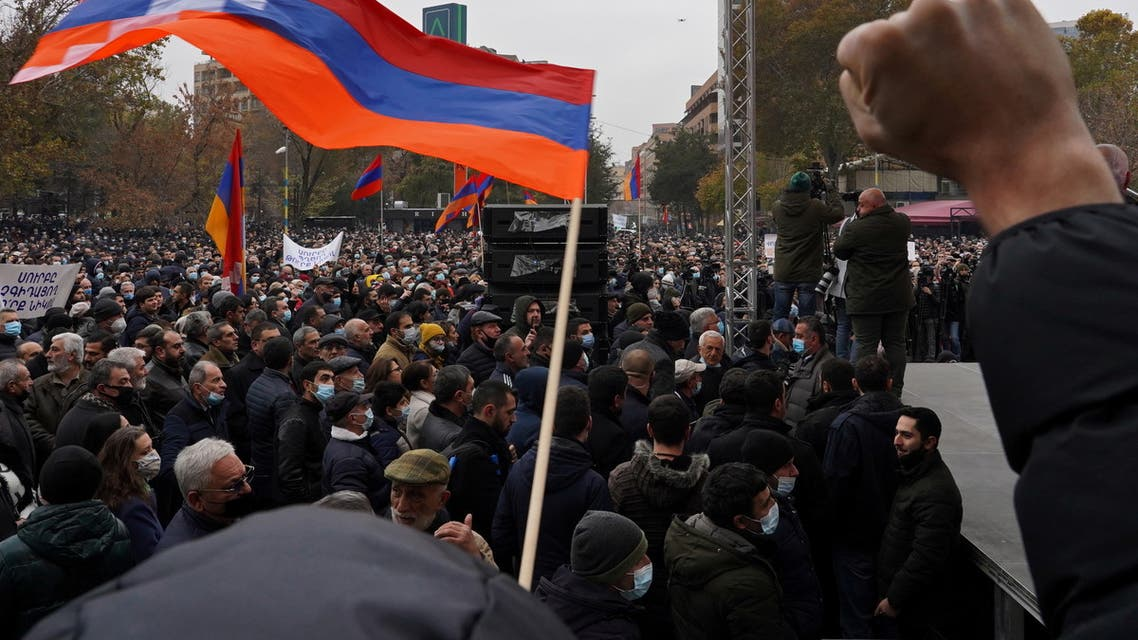 People attend an opposition rally to demand the resignation of Armenian Prime Minister Nikol Pashinyan following the signing of a deal to end a military conflict over Nagorno-Karabakh, in Yerevan, Armenia December 5, 2020. REUTERS/Artem Mikryukov