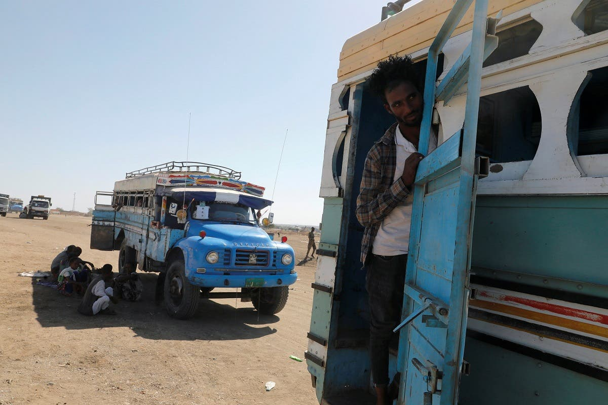 An Ethiopian refugee looks out of a bus window which transports him from the Hamdeyat refugee transit camp, which houses refugees fleeing the fighting in the Tigray region, on the border in Sudan, December 1, 2020. (File photo: Reuters)