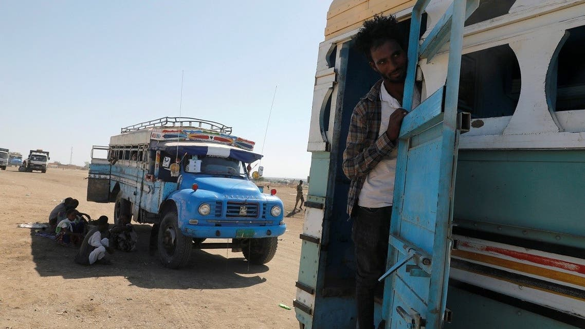 An Ethiopian refugee looks out of a bus window which transports him from the Hamdeyat refugee transit camp, which houses refugees fleeing the fighting in the Tigray region, on the border in Sudan, December 1, 2020. (Reuters/Baz Ratner)