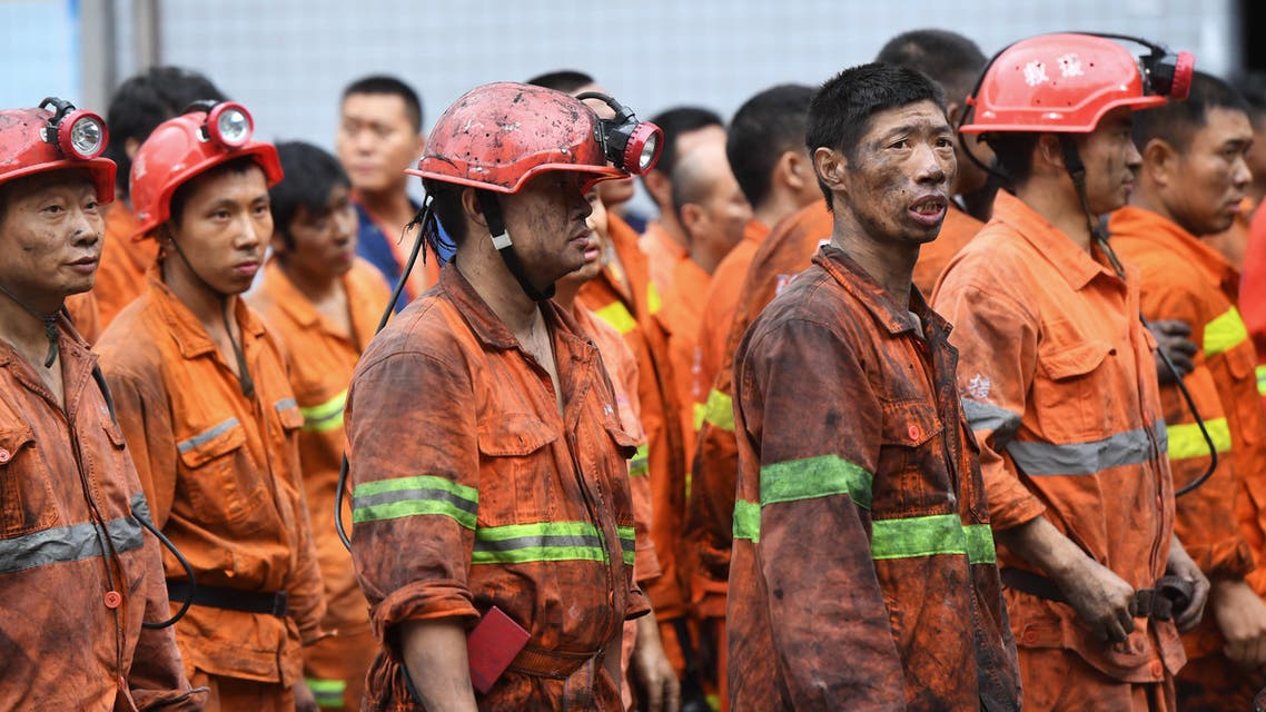 Rescuers wait outside the Songzao Coal Mine near Chongqing, in southwest China on September 27, 2020. (File photo, AFP)