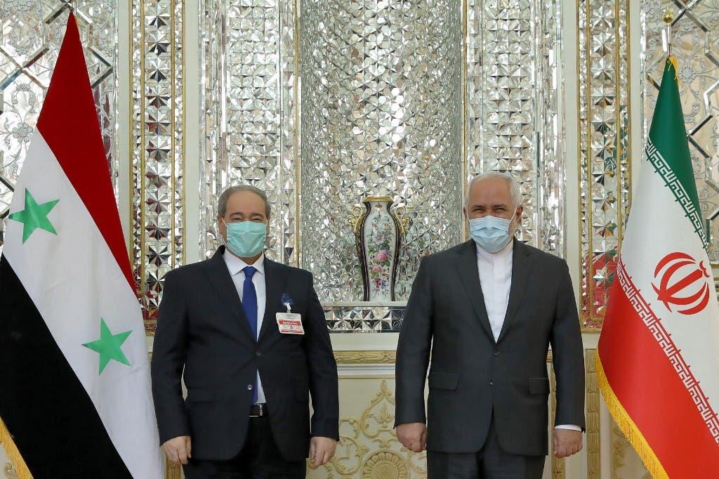 وزيرا خارجية إيران جواد ظريف، وسوريا فيصل المقداد