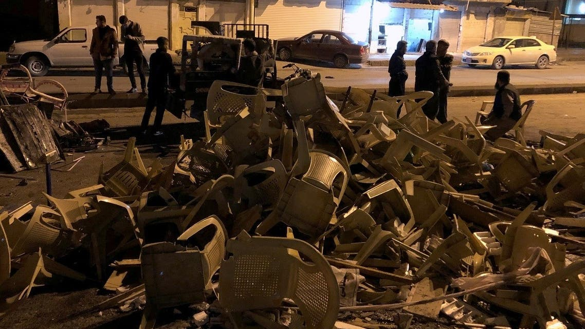 Damaged chairs from a building for the Kurdistan Islamic Group party are seen after it was attacked during anti-government protests on the outskirt of Sulaimaniyah, Iraq December 7, 2020. (Reuters/Ako Rasheed)
