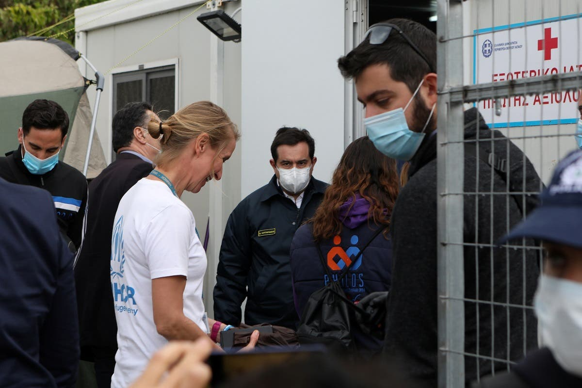 Greek Migration Minister Notis Mitarachi (C) visits the Moria camp for refugees and migrants, following the coronavirus disease (COVID-19) outbreak, on the island of Lesbos, Greece, May 3, 2020. (Reuters/Elias Marcou)