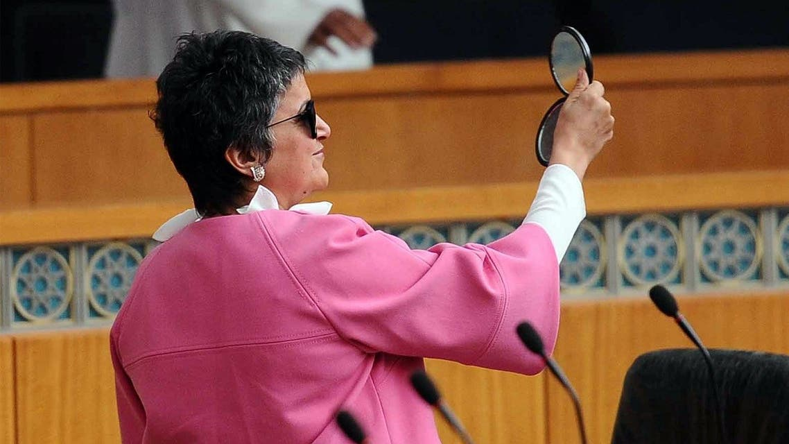 Kuwaiti MP Safa Al-Hashem checks her sun glasses during a parliament session at the Kuwait's national assembly in Kuwait City on April 30,2014.  (AFP)