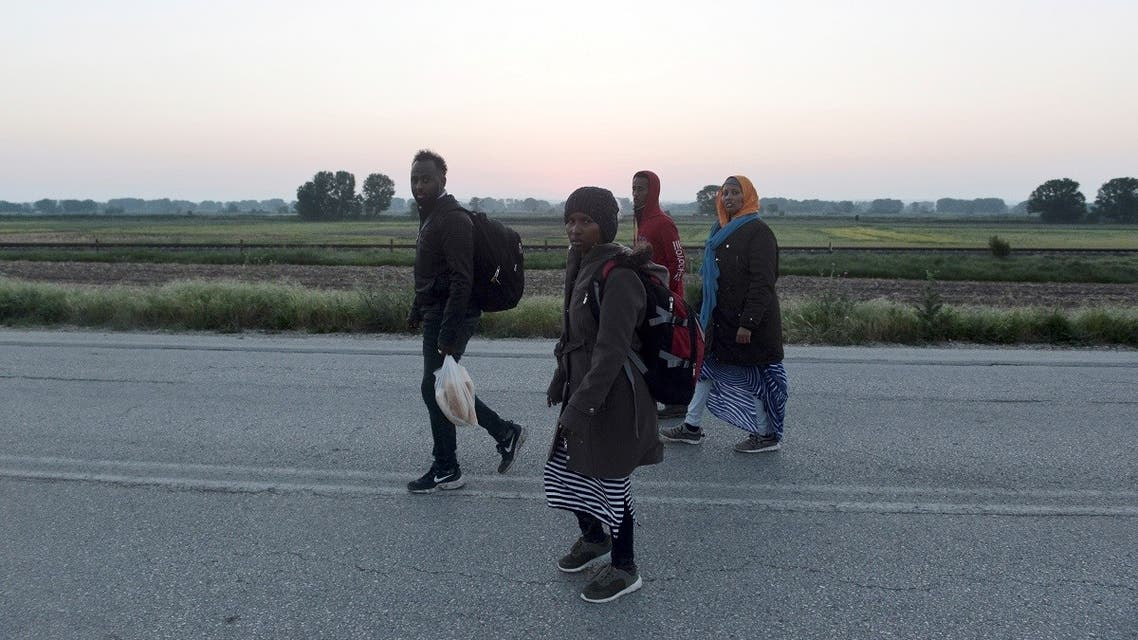Somali refugees walk after they crossed the Evros river, the natural boundary with Turkey in northeastern Greece, in the village of Neo Cheimonio on April 28, 2018. (Sakis Mitrolidis/AFP)