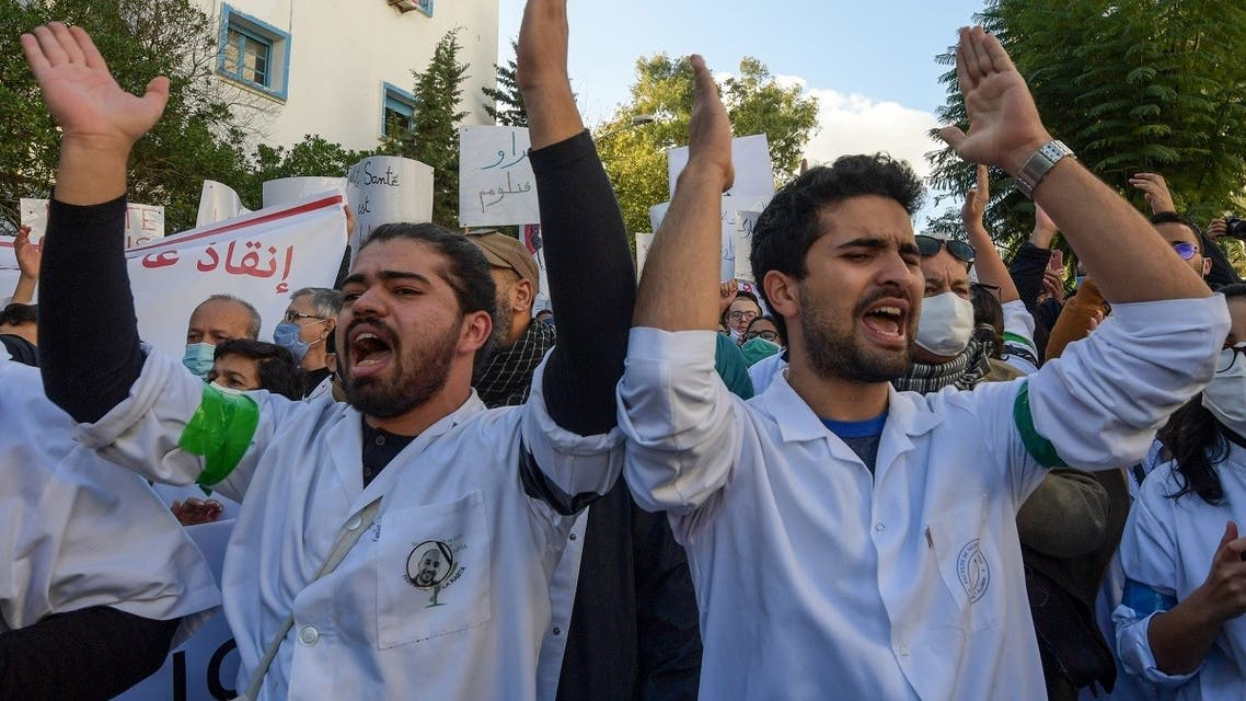 Tunisian doctors chant slogans during a demonstration demanding the resignation of the Health Minister, in the capital Tunis on December 8, 2020. (Fethi Belaid/AFP)