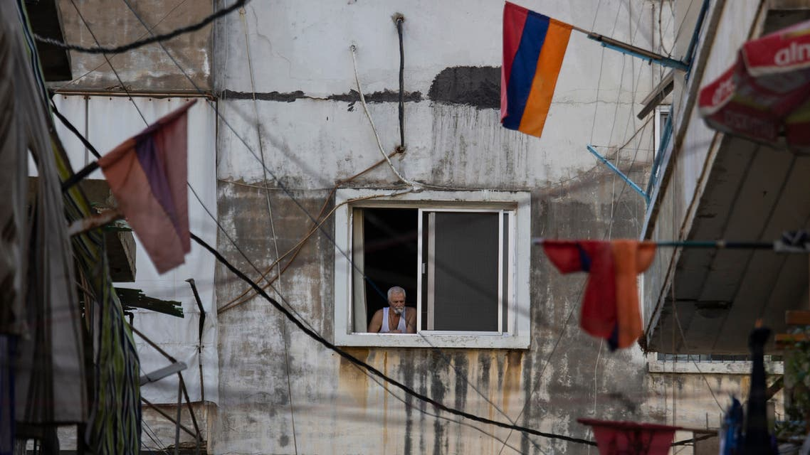 Armenian national flags hang from apartment balconies in the main Armenian district of the northern Beirut suburb of Bourj Hammoud, Lebanon, Tuesday, Oct. 6, 2020. (AP)