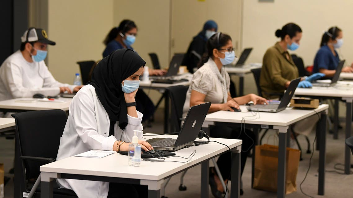 Employees at the Dubai COVID-19 Command and Control Center at Mohammed bin Rashid University in the Gulf emirate on May 20, 2020. (File photo: AFP)