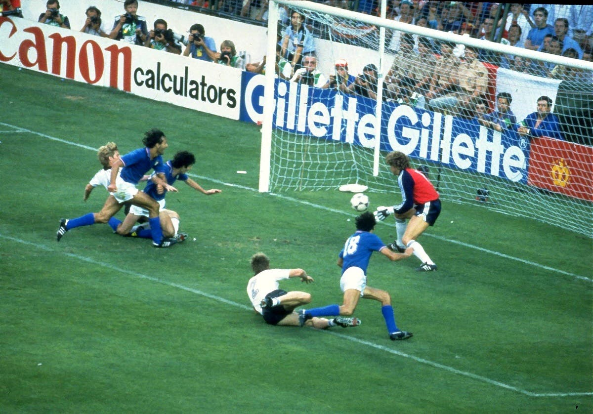 Paolo Rossi scores a goal for Italy in the 1982 FIFA World Cup Final against Germany in Spain. (Reuters)