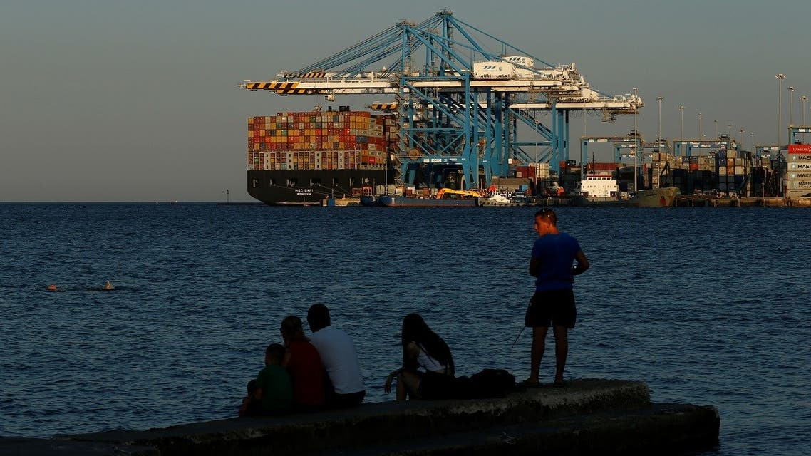 A man fishes from a jetty as containers are unloaded from the container ship MSC Bari at Malta Freeport in Birzebbuga, Malta . (File photo: Reuters)