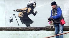 Mural of sneezing woman by Banksy appears on England's steepest street