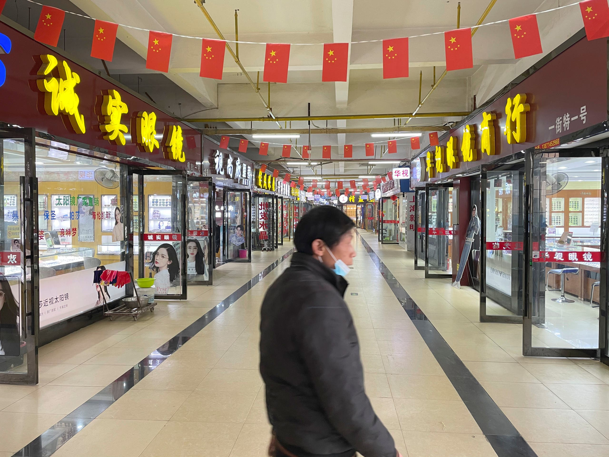 Shops are seen ope almost a year after the start of the coronavirus outbreak, in Wuhan, Hubei province. (File photo: Reuters)