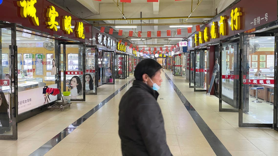 Optical shops are seen open which were originally at the second floor of the Huanan seafood market, where the coronavirus believed to have first surfaced, almost a year after the start of the coronavirus disease (COVID-19) outbreak, in Wuhan, Hubei province, China December 8, 2020. Picture taken December 8, 2020. (Reuters)