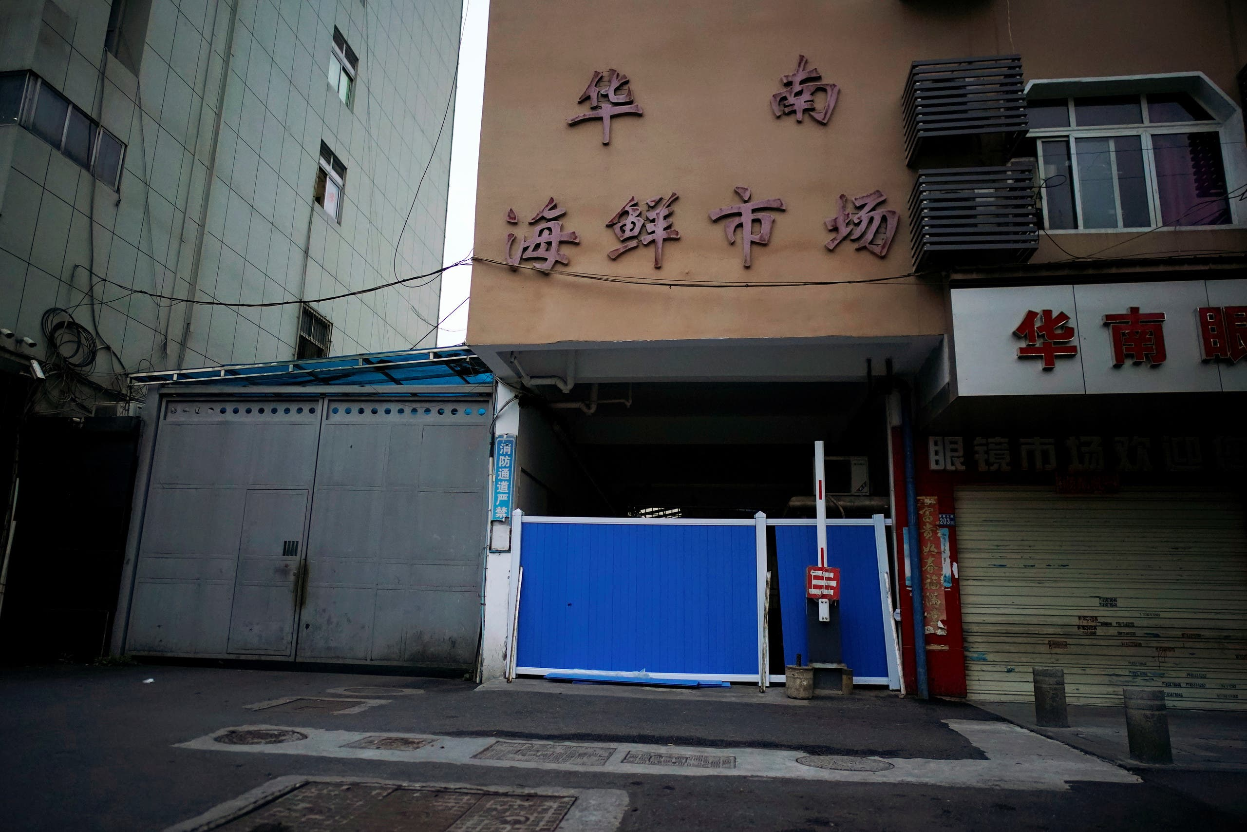 A blocked entrance to Huanan seafood market, where the coronavirus that can cause COVID-19 is believed to have first surfaced, is seen in Wuhan, Hubei province, China March 30, 2020. Picture taken March 30, 2020. (Reuters)
