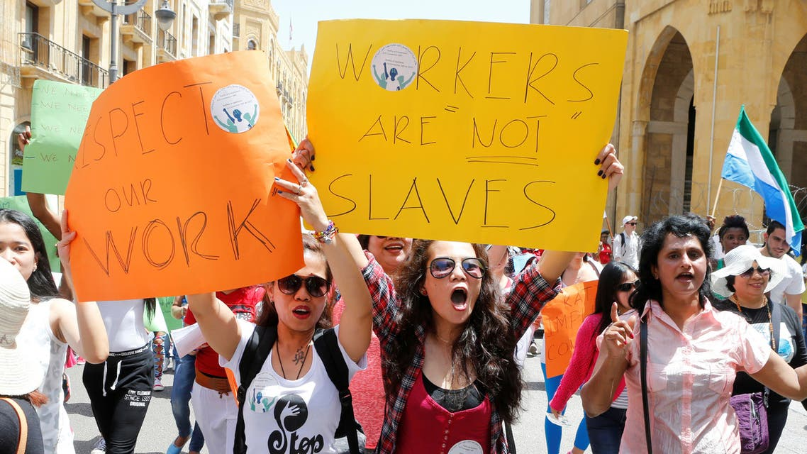 Migrant domestic workers hold placards and chant slogans during a parade to support the rights of migrant domestic workers, on May Day in downtown Beirut, Lebanon May 1, 2016. (Reuters)