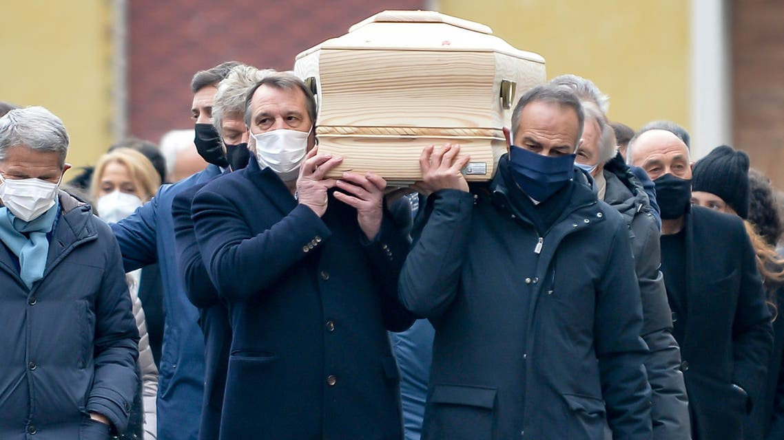 His former teammates in the Italian winning World Cup team, from left, Marco Tardelli, Antonio Cabrini, Giampiero Marini and Alessandro Altobelli carry the coffin of Paolo Rossi as it leaves the church after his funeral service, in Vicenza, Italy, Saturday, Dec. 12, 2020. Paolo Rossi, who led Italy to the 1982 World Cup title and later worked as a soccer commentator in his home country, died at the age of 64. (Paola Garbuio/LaPresse via AP)