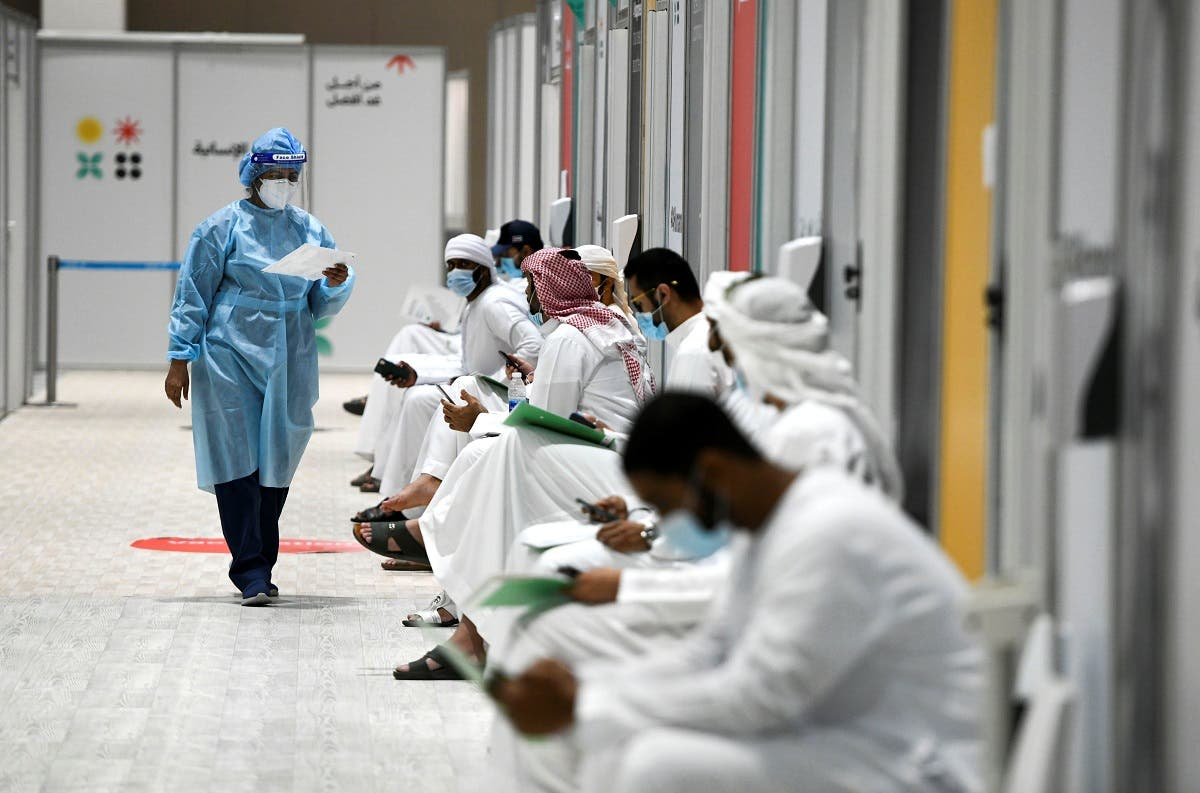 People sit as they wait their turn for vaccine trials in Abu Dhabi, UAE, October 6, 2020. (Reuters)