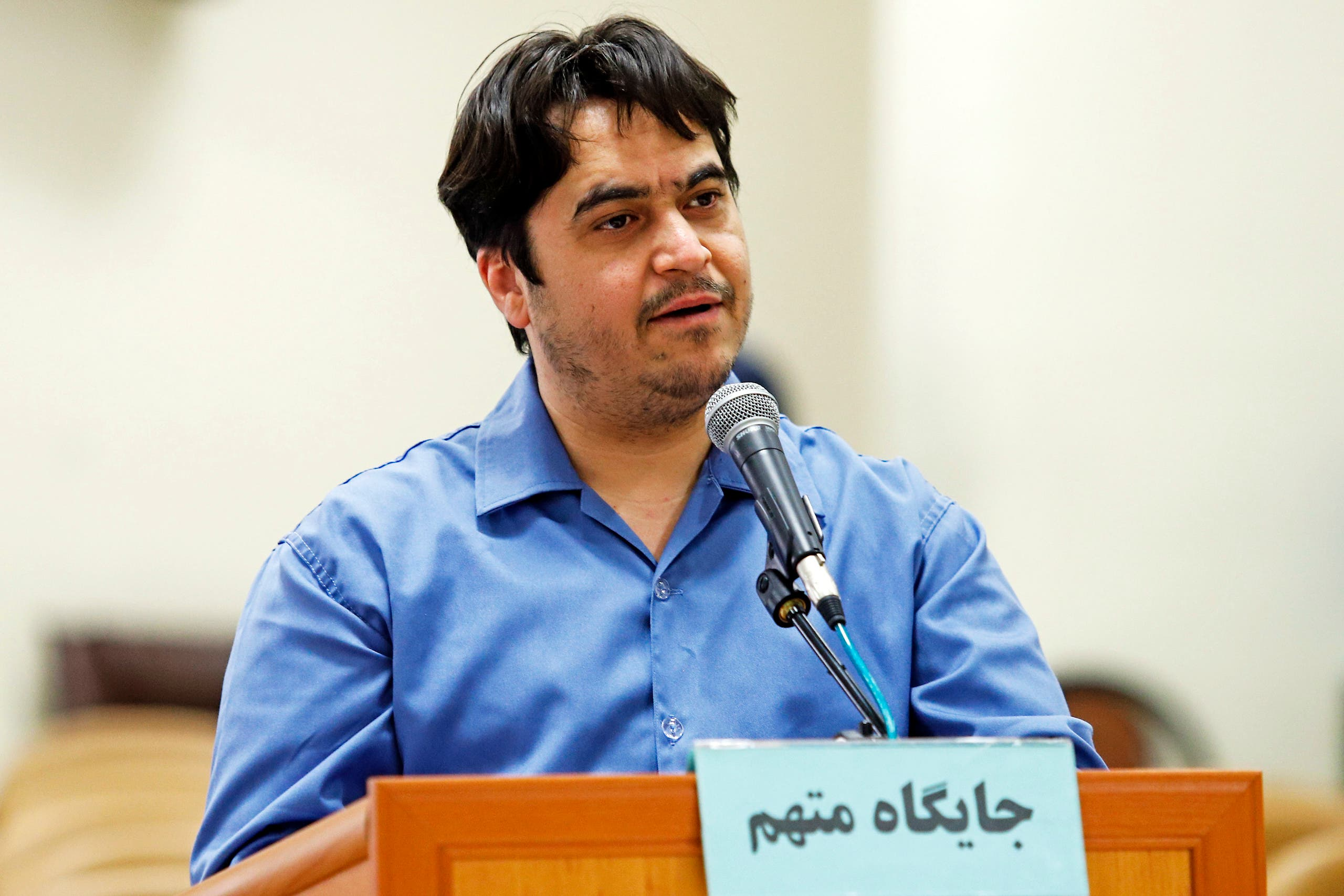 Ruhollah Zam speaks during his trial at Iran's Revolutionary Court in Tehran on June 30, 2020. (AFP)