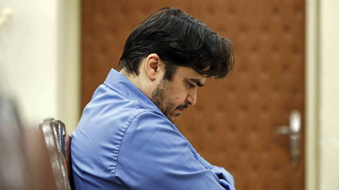 Ruhollah Zam during his trial at Iran's Revolutionary Court in Tehran on June 2, 2020. (AFP)