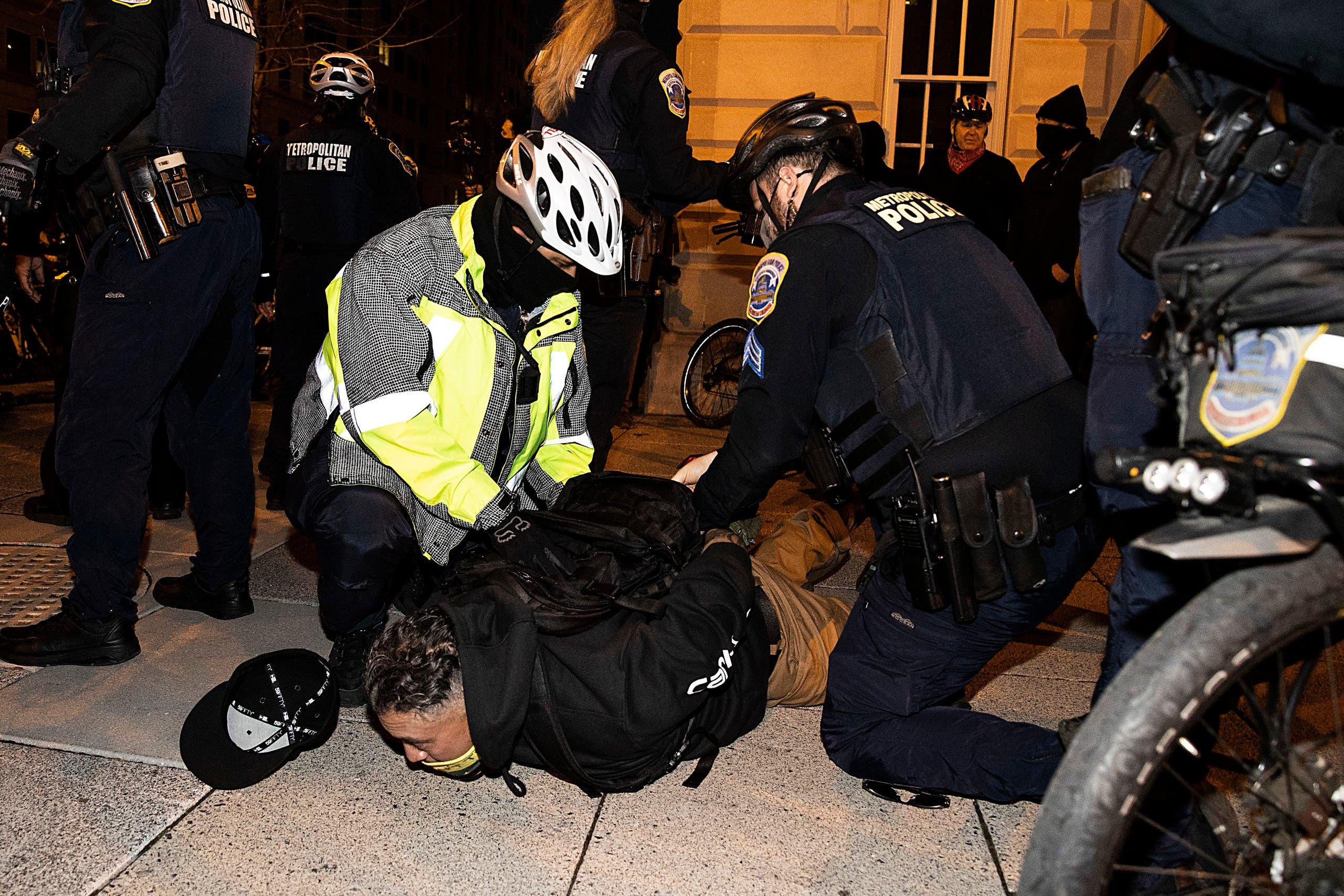 Washington DC Police arrest a member of the Proud Boys near Black Lives Matter Plaza on December 12, 2020 in Washington, DC. (AFP)