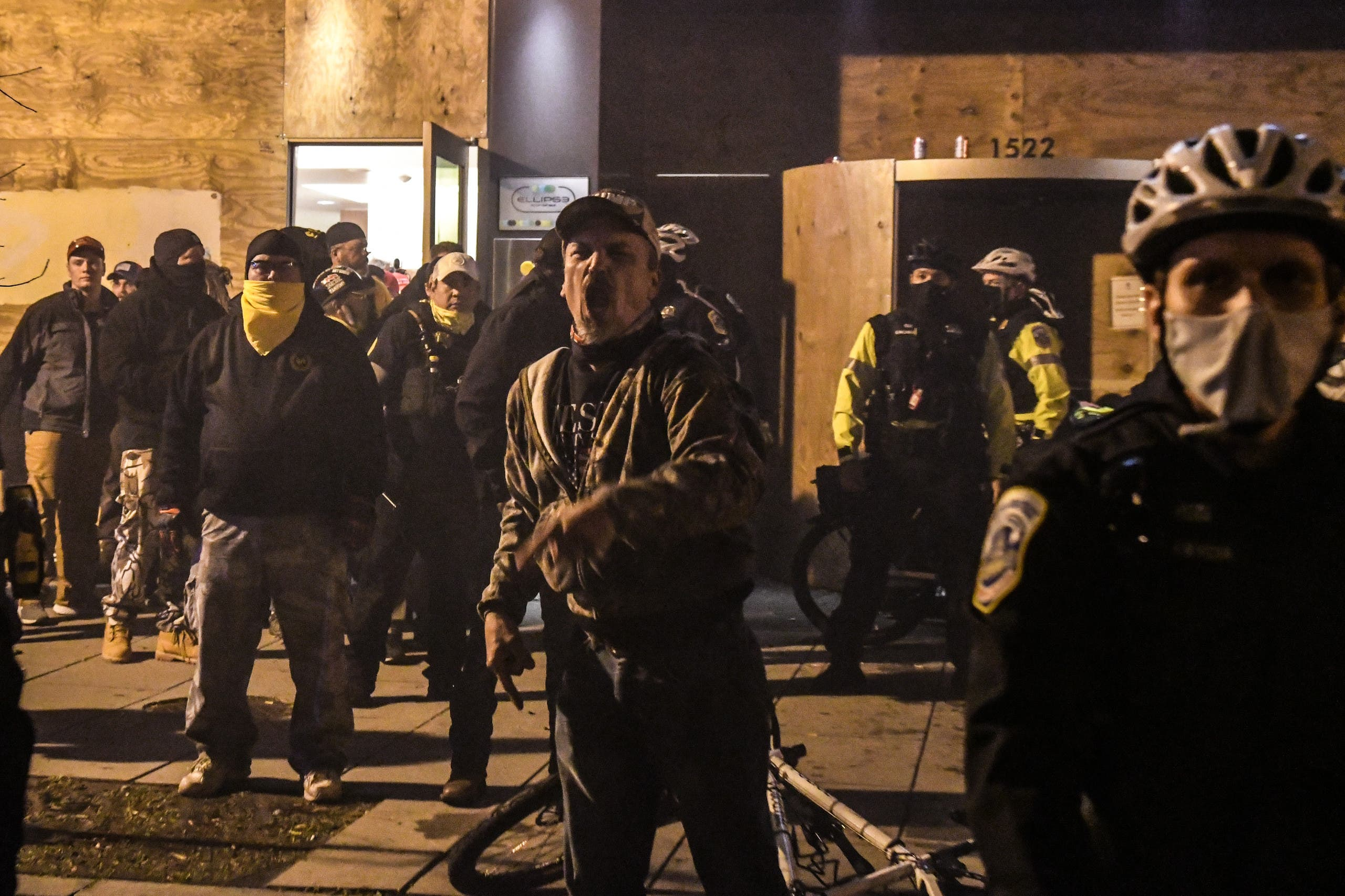 Members of the Proud Boys yell in front of a hotel during a protest on December 12, 2020 in Washington, DC.  (AFP)