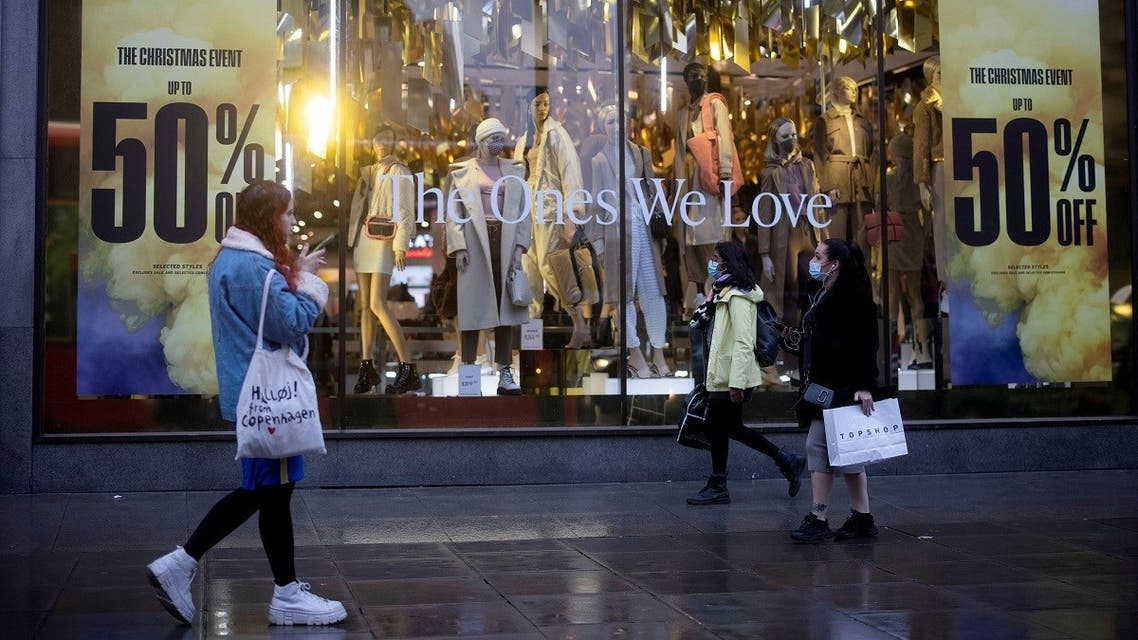 Shoppers walk down Oxford Street, amid the coronavirus outbreak in London, Britain, on December 13, 2020. (Reuters)