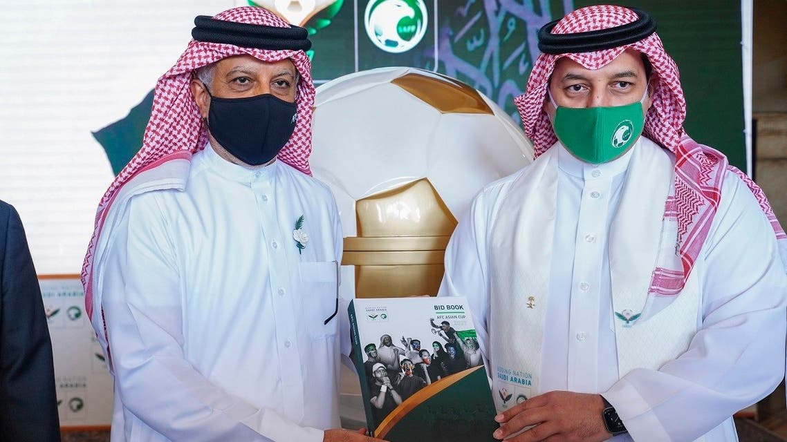 SAFF President Yasser Almisehal presents the official bid book to the AFC President Shaikh Salman Bin Ibrahim Al Khalifa for staging the 2027 AFC Asian Cup. (Supplied)