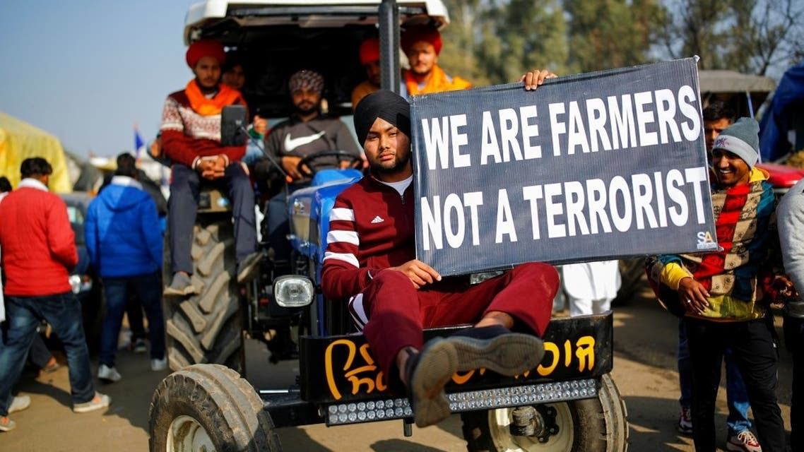 Farmers arrive in a tractor to attend a protest against the newly passed farm bills at Singhu border near New Delhi, India, on December 14, 2020. (Reuters)