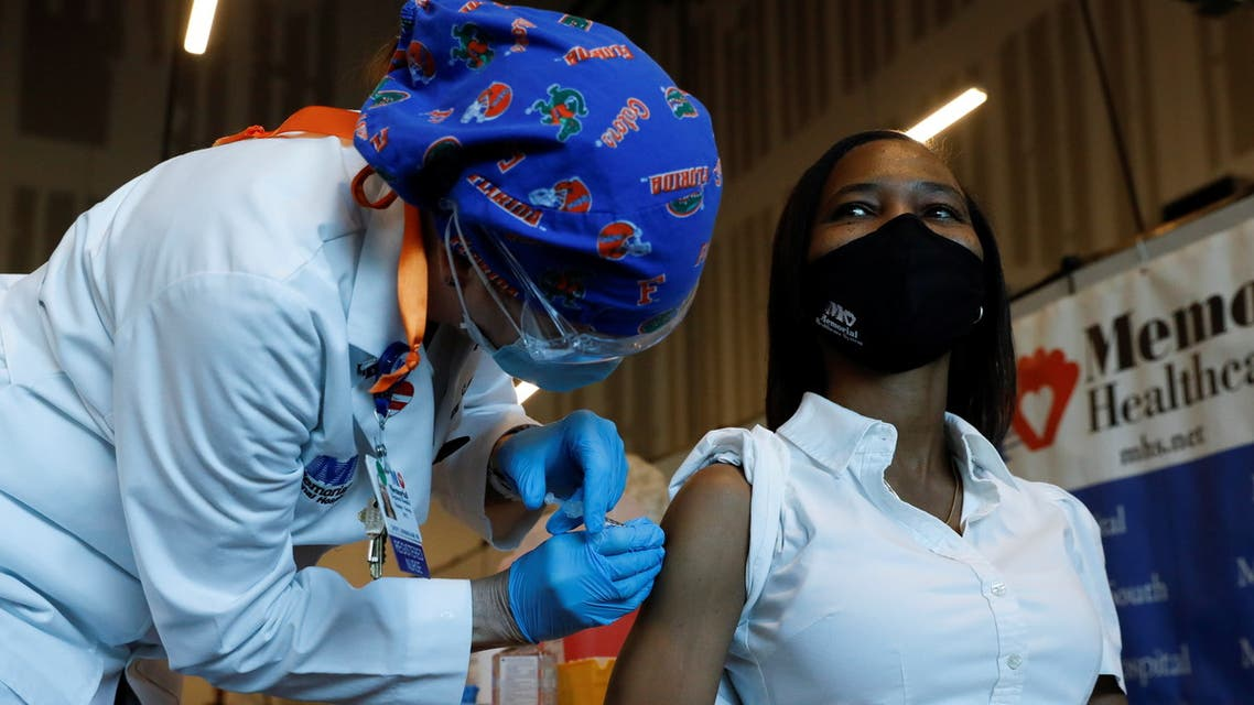 Nurse Cheryl Birmingham administers the Pfizer-BioNTech COVID-19 Vaccine to registered nurse La Tanya Forbes at Memorial Healthcare System facility in Miramar, Florida, US, December 14, 2020. (Reuters)