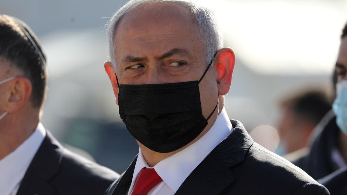 Israeli Prime Minister Benjamin Netanyahu attends the arrival of a DHL plane carrying a first batch of Pfizer/BioNTech COVID-19 vaccine, following the outbreak of the coronavirus disease (COVID-19), at Ben Gurion Airport near Tel Aviv, Israel December 9, 2020. (Abir Sultan via Reuters)
