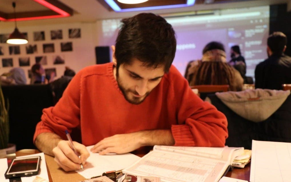 Kamyar Sheykh working on Tech Cafe's accounting. (Elahe Hosseini)