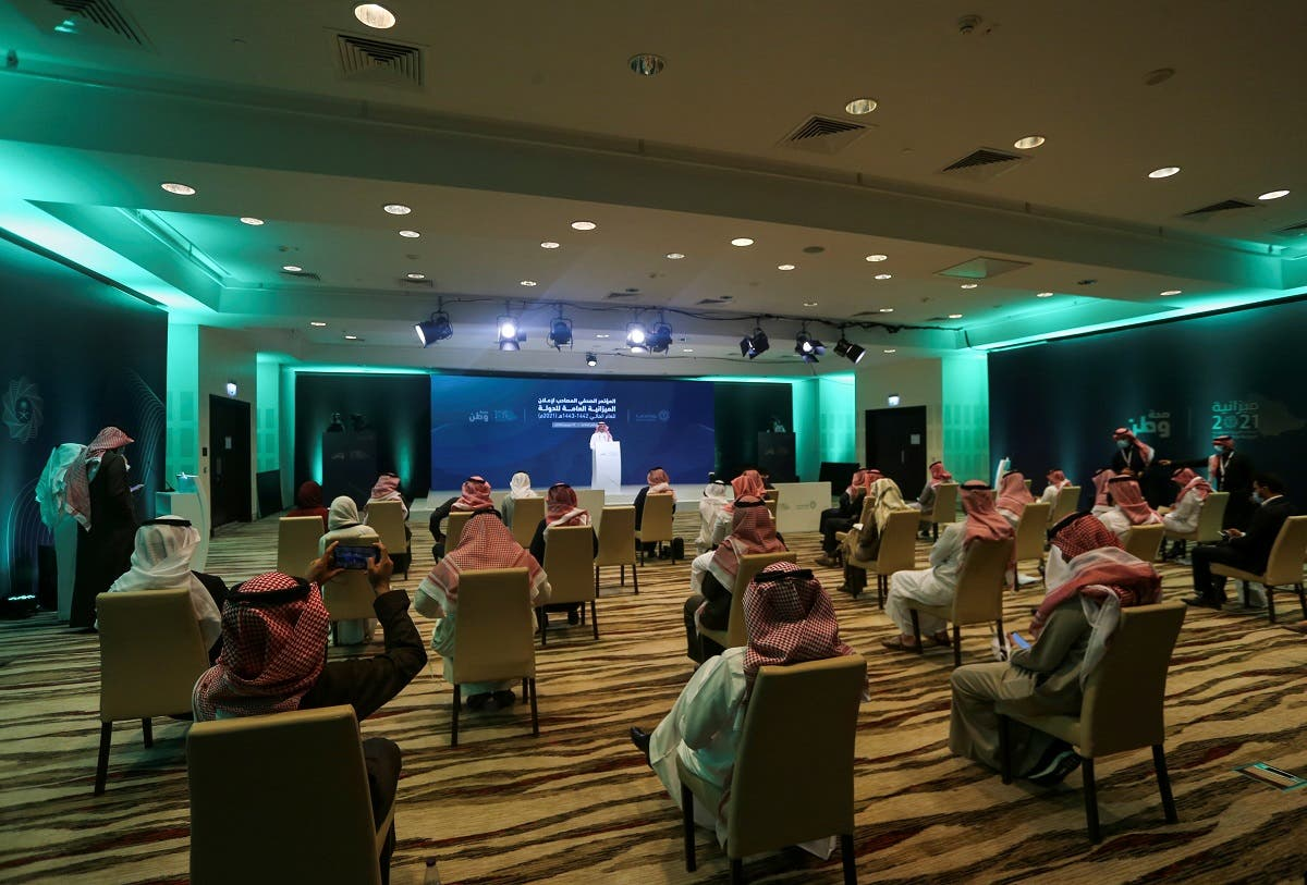 Reporters attent Saudi Minister of Finance Mohammed al-Jadaan's news conference to announce the country's 2021 budget. (Reuters)