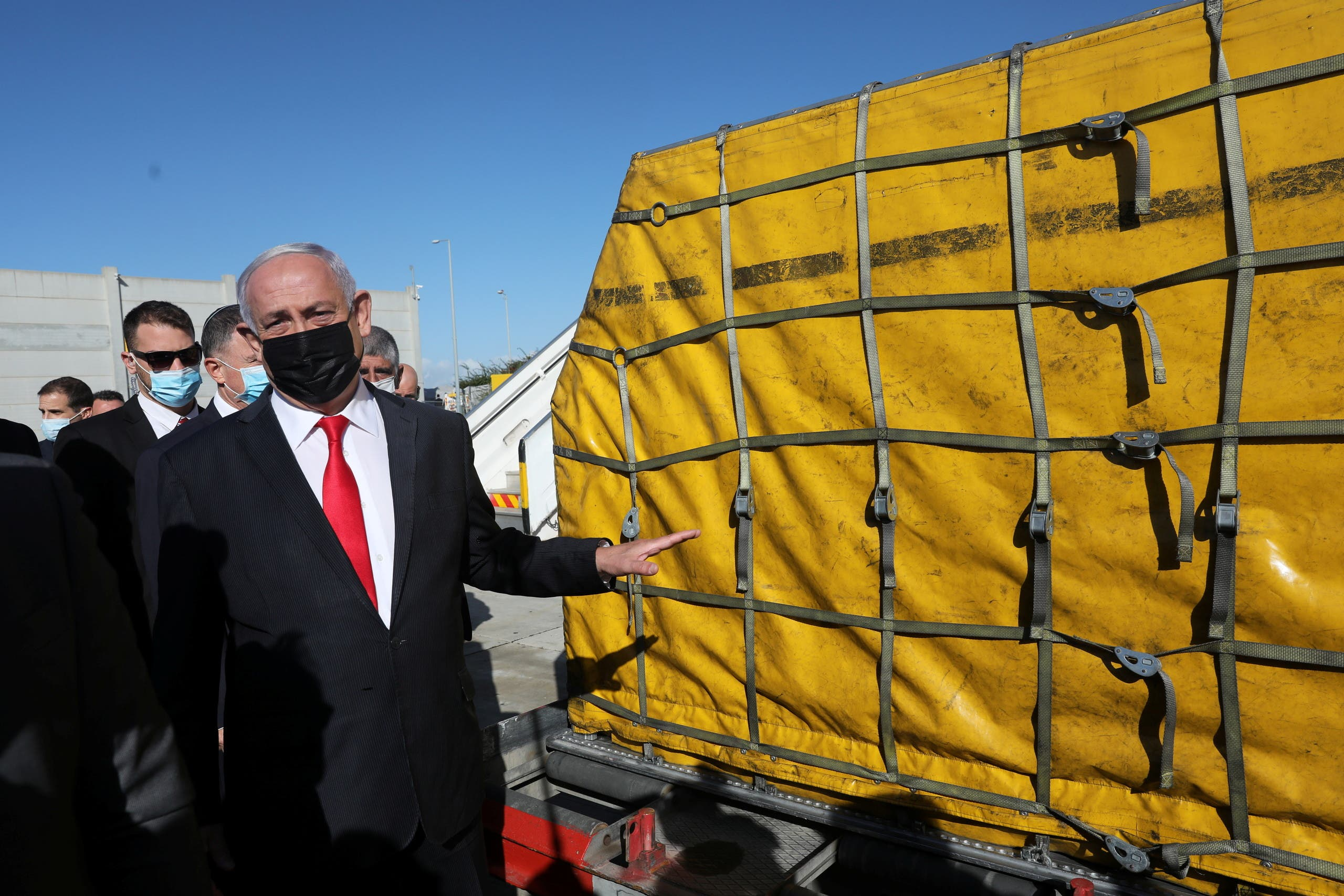 Israeli Prime Minister Benjamin Netanyahu attends the arrival of a DHL plane carrying a first batch of Pfizer/BioNTech COVID-19 vaccine, following the outbreak of the coronavirus disease (COVID-19), at Ben Gurion Airport near Tel Aviv, Israel December 9, 2020. (Reuters)