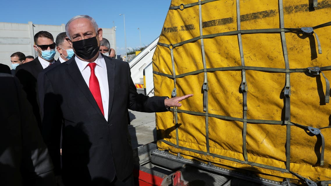 Israeli Prime Minister Benjamin Netanyahu attends the arrival of a DHL plane carrying a first batch of Pfizer/BioNTech COVID-19 vaccine, following the outbreak of the coronavirus disease (COVID-19), at Ben Gurion Airport near Tel Aviv, Israel December 9, 2020. Abir Sultan/Pool via REUTERS