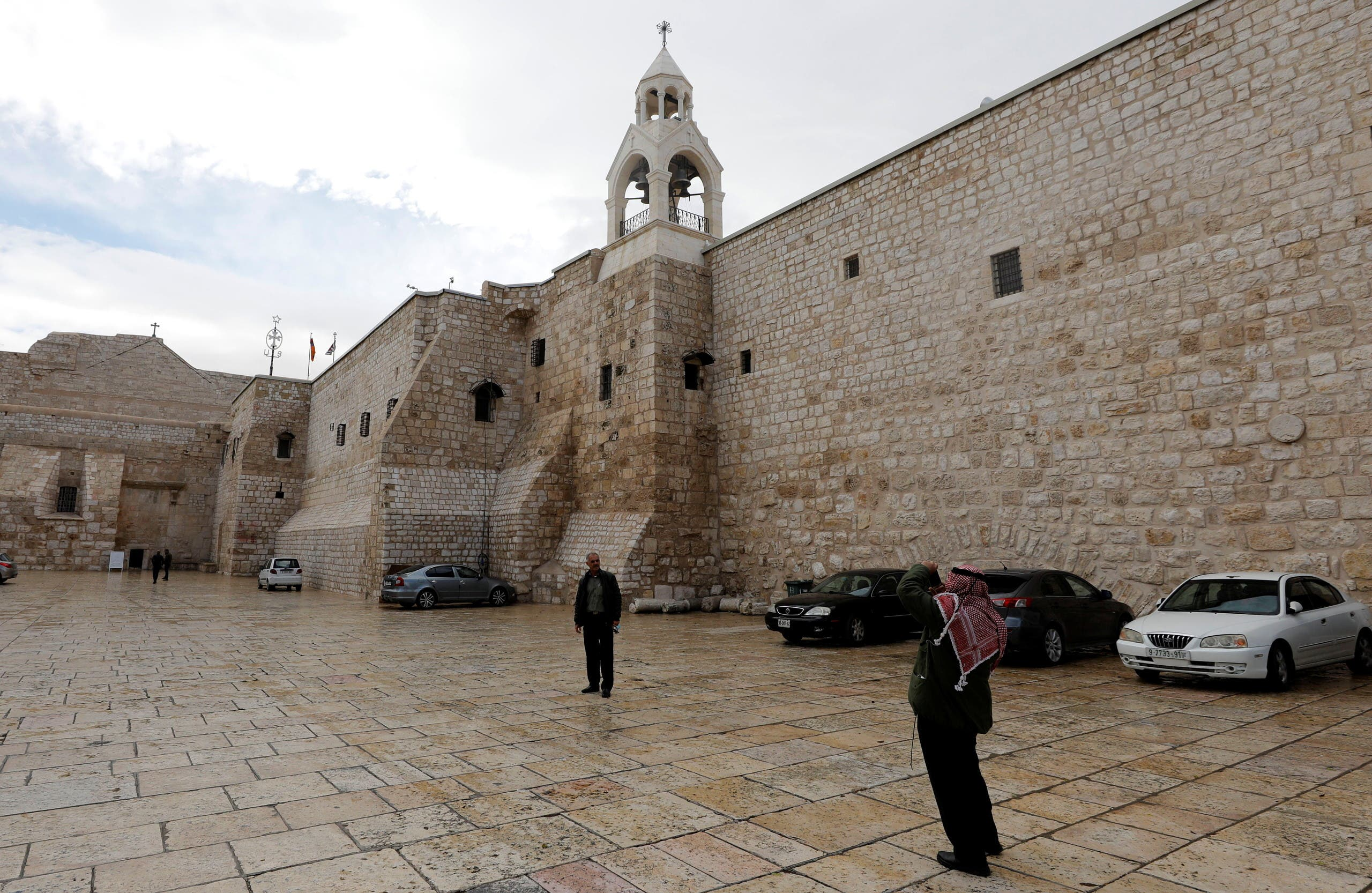 A Palestinian man poses for a picture outside the Church of the Nativity, amid the coronavirus disease (COVID-19) outbreak, in Bethlehem in the Israeli-occupied West Bank November 26, 2020. Picture taken November 26, 2020. (Reuters/Mussa Qawasma)
