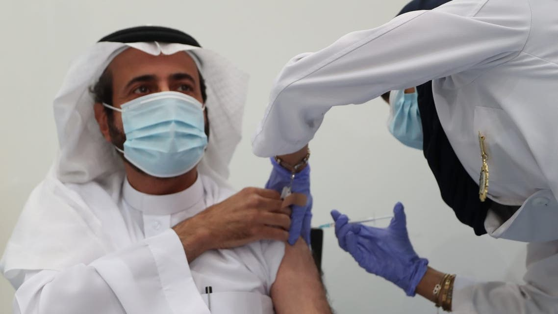 Saudi Arabia's Minister of Health, Dr. Tawfiq al-Rabiah, receives the coronavirus vaccine. (Via @SaudiMOH Twitter)