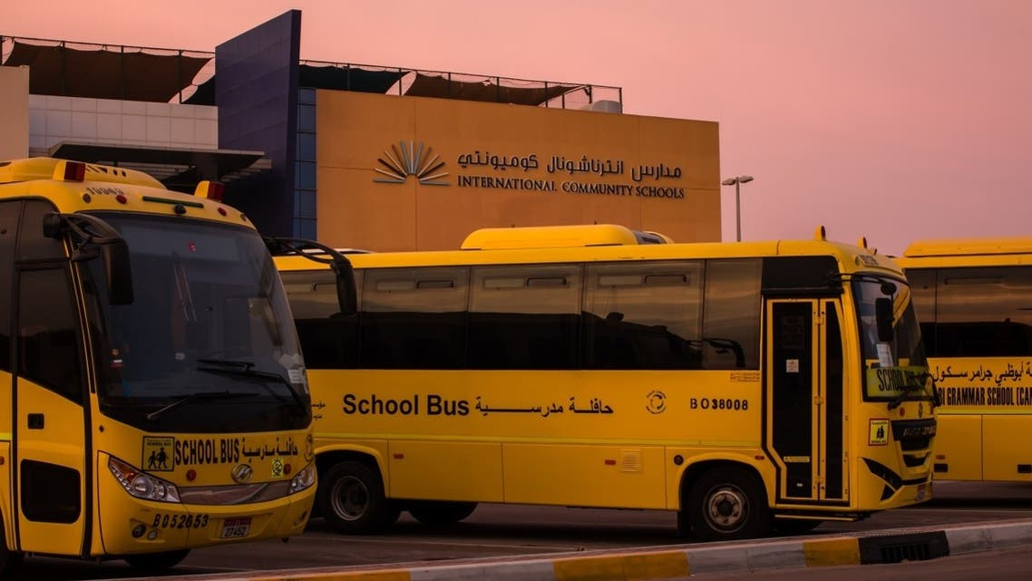Closed school and yellow school buses parked in Abu Dhabi during coronavirus pandemic. (iStock)