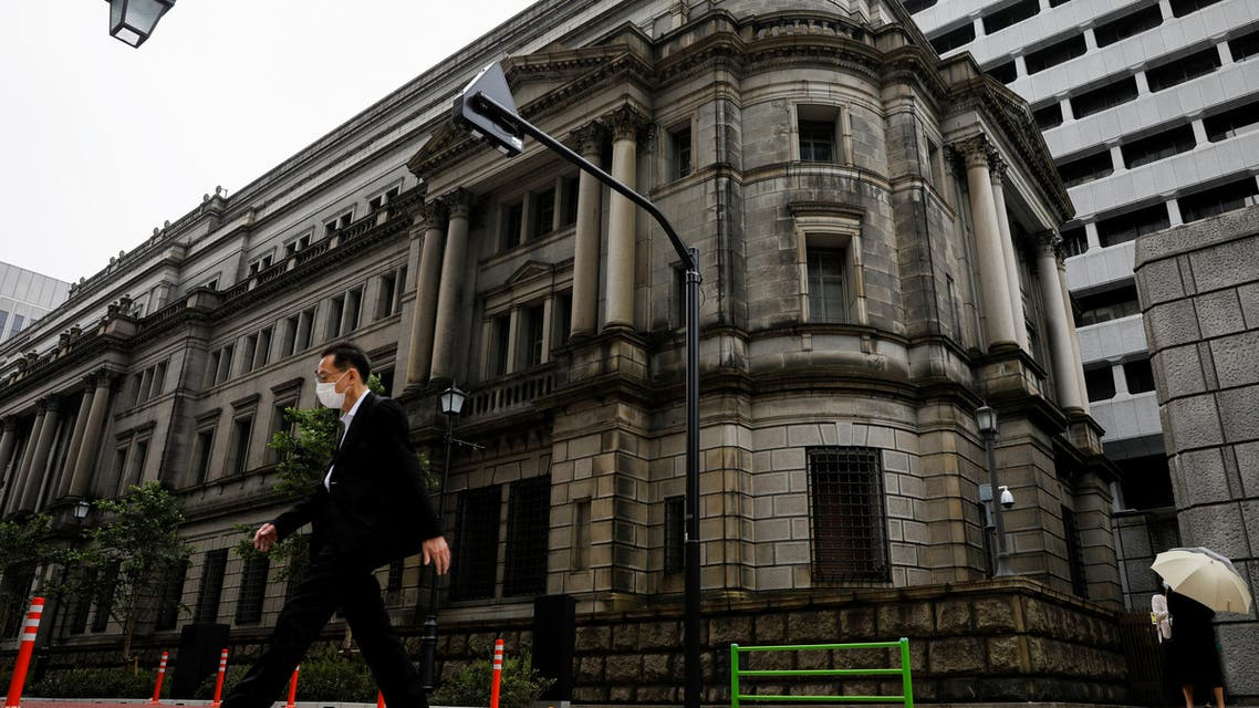 A man wearing a protective mask walks past the headquarters of the Bank of Japan amid the coronavirus disease (COVID-19) outbreak in Tokyo, Japan, May 22, 2020. (Reuters)