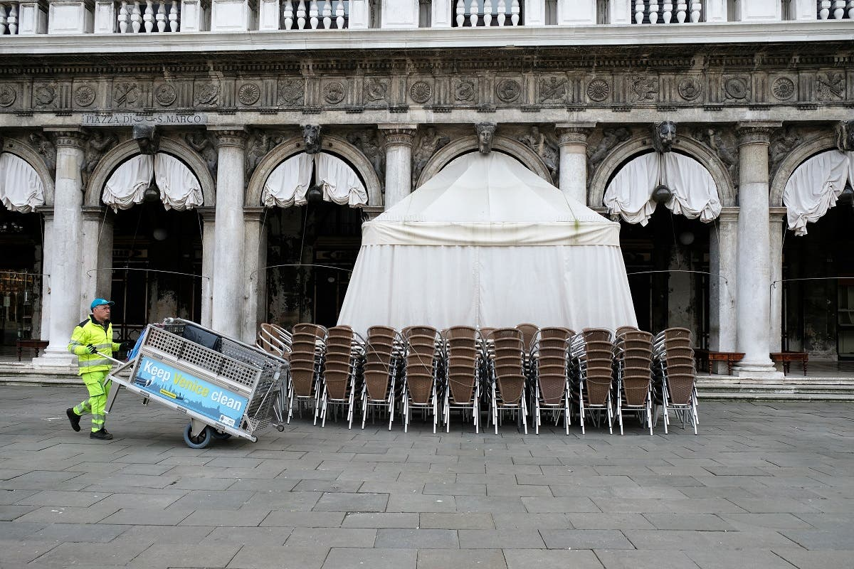 Chairs are seen outside the closed Caffe Florian after the Italian government imposed a virtual lockdown on the north of Italy including Venice to try to contain a coronavirus outbreak. (Reuters)