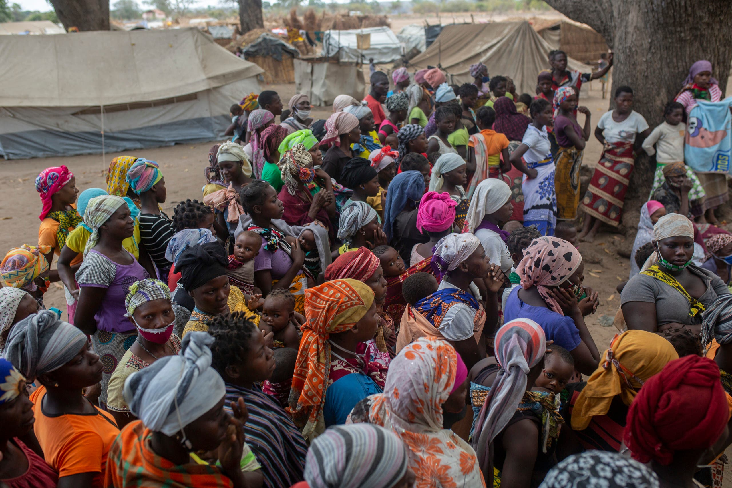 Displaced women meet on December 11, 2020 at the Centro Agrario de Napala where hundreds of displaced arrived in recent months are sheltered, fleeing attacks by armed insurgents in different areas of the province of Cabo Delgado, in northern Mozambique. (Alfredo Zuniga/AFP)