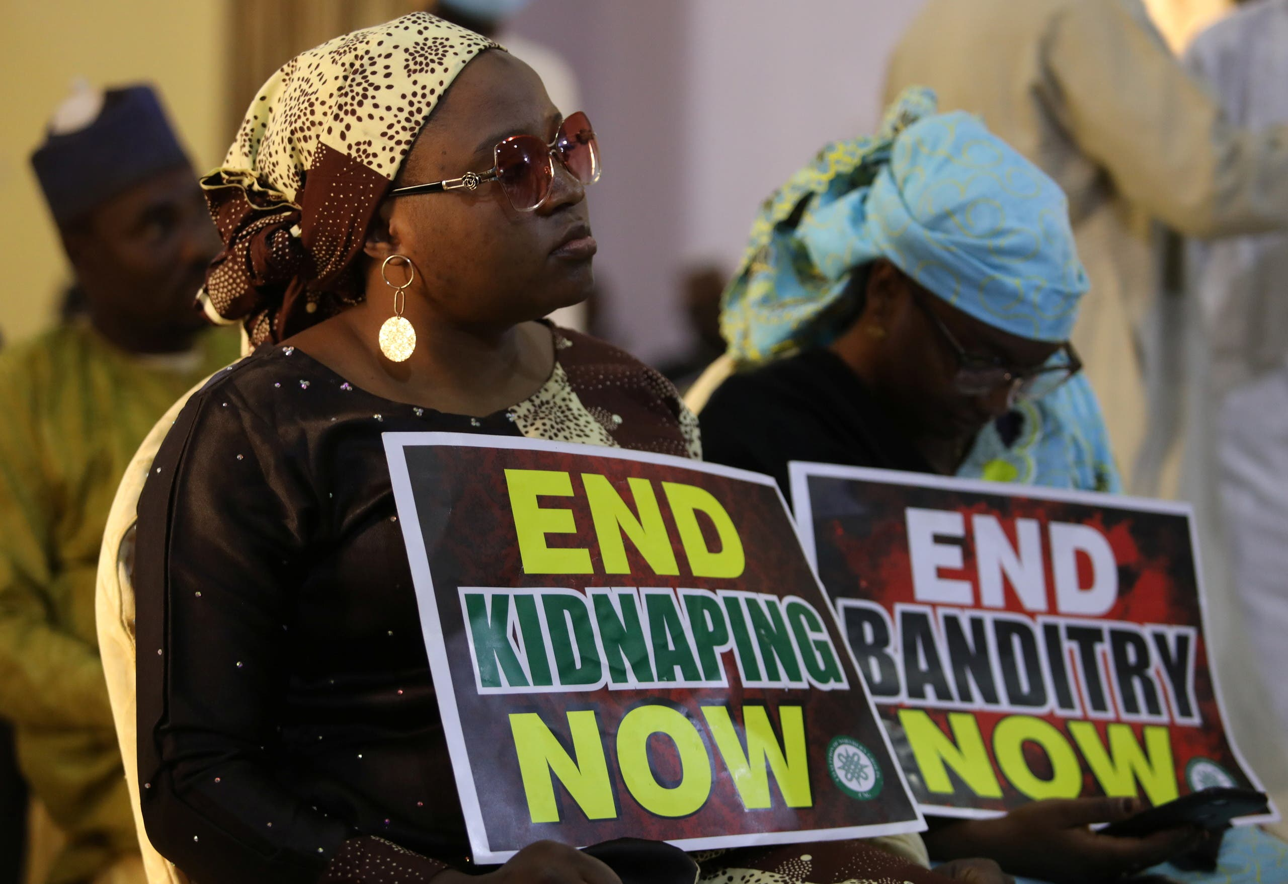 A demonstrator holds a sign during a protest to urge authorities to rescue hundreds of abducted schoolboys, in northwestern state of Katsina, Nigeria, December 17, 2020. (Reuters/Afolabi Sotunde)