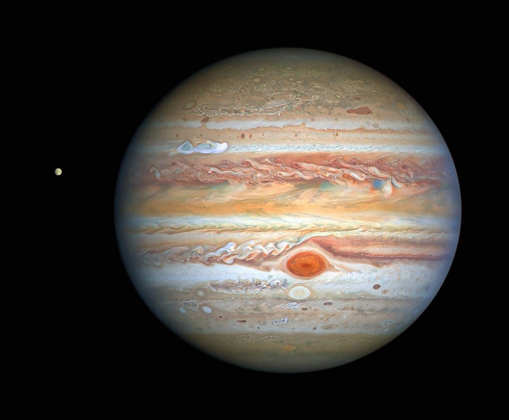 This handout photograph obtained on September 17, 2020 and released by NASA/ESA Hubble Space Telescope shows Jupiter and its moon Europa. (File photo: NASA/ESA/Hubble/AFP)