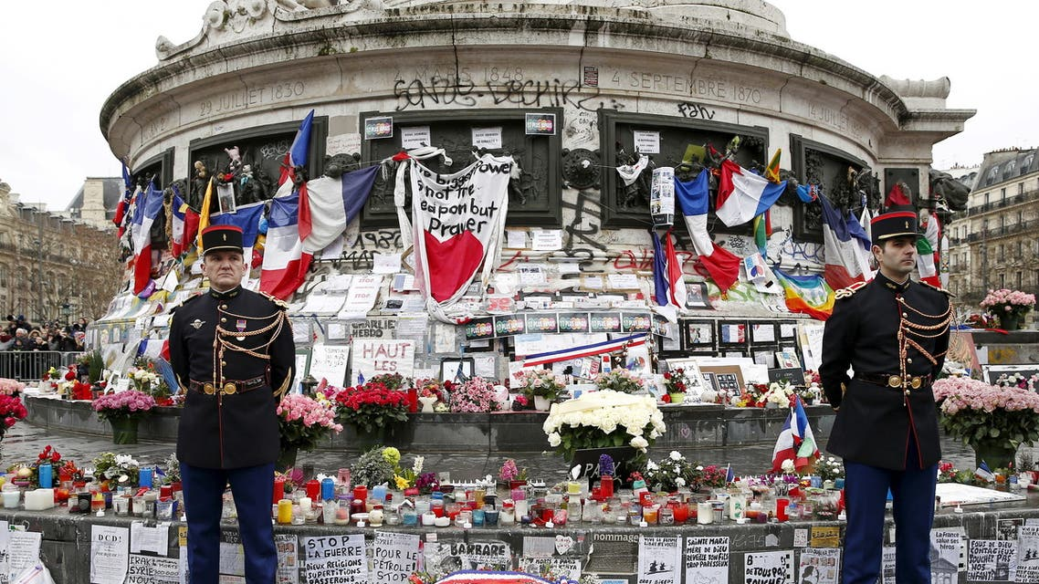 French Republican guards stand during a ceremony at Place de la Republique square to pay tribute to the victims of last year's shooting at the French satirical newspaper Charlie Hebdo, in Paris, France, January 10, 2016. (Reuters/Yohan Valat/Pool)