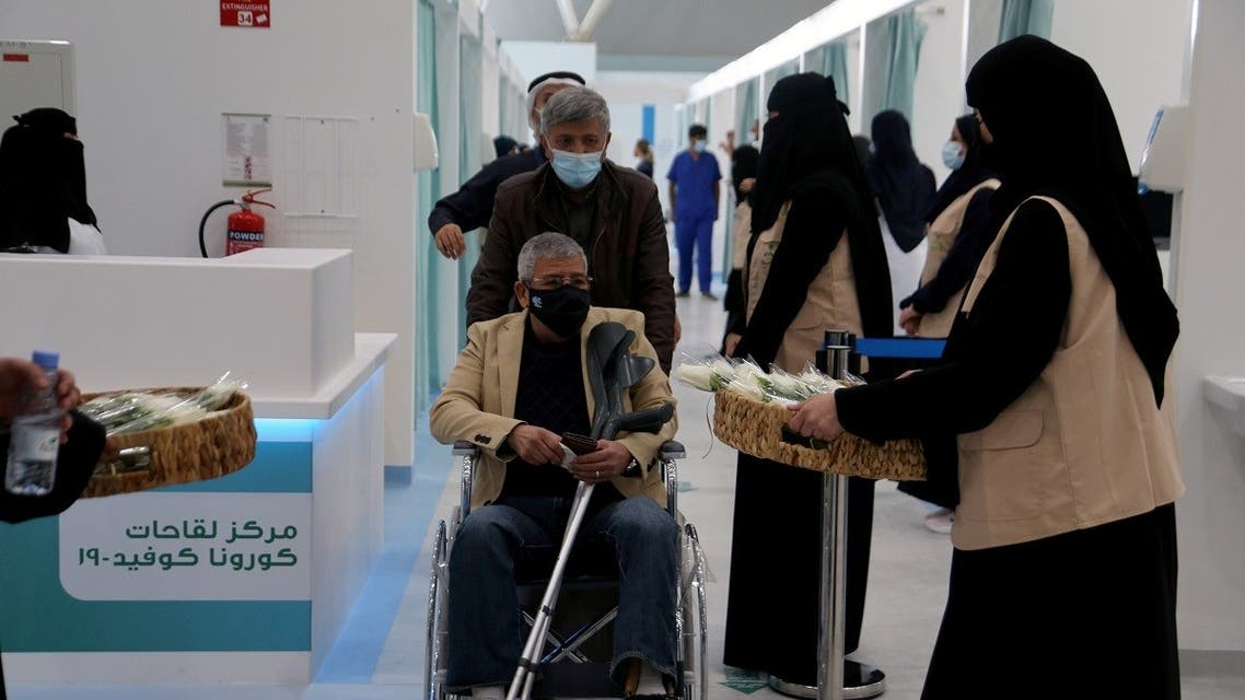 A man in a wheelchair leaving after he received dose of a coronavirus disease (COVID-19) vaccine, in Riyadh. (Reuters)