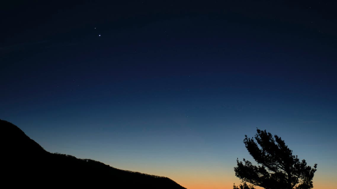 In this Sunday, December 13, 2020 photo, Saturn, top, and Jupiter, below, are seen after sunset from Shenandoah National Park in Luray, Va. (File photo: Bill Ingalls/NASA via The Associated Press)