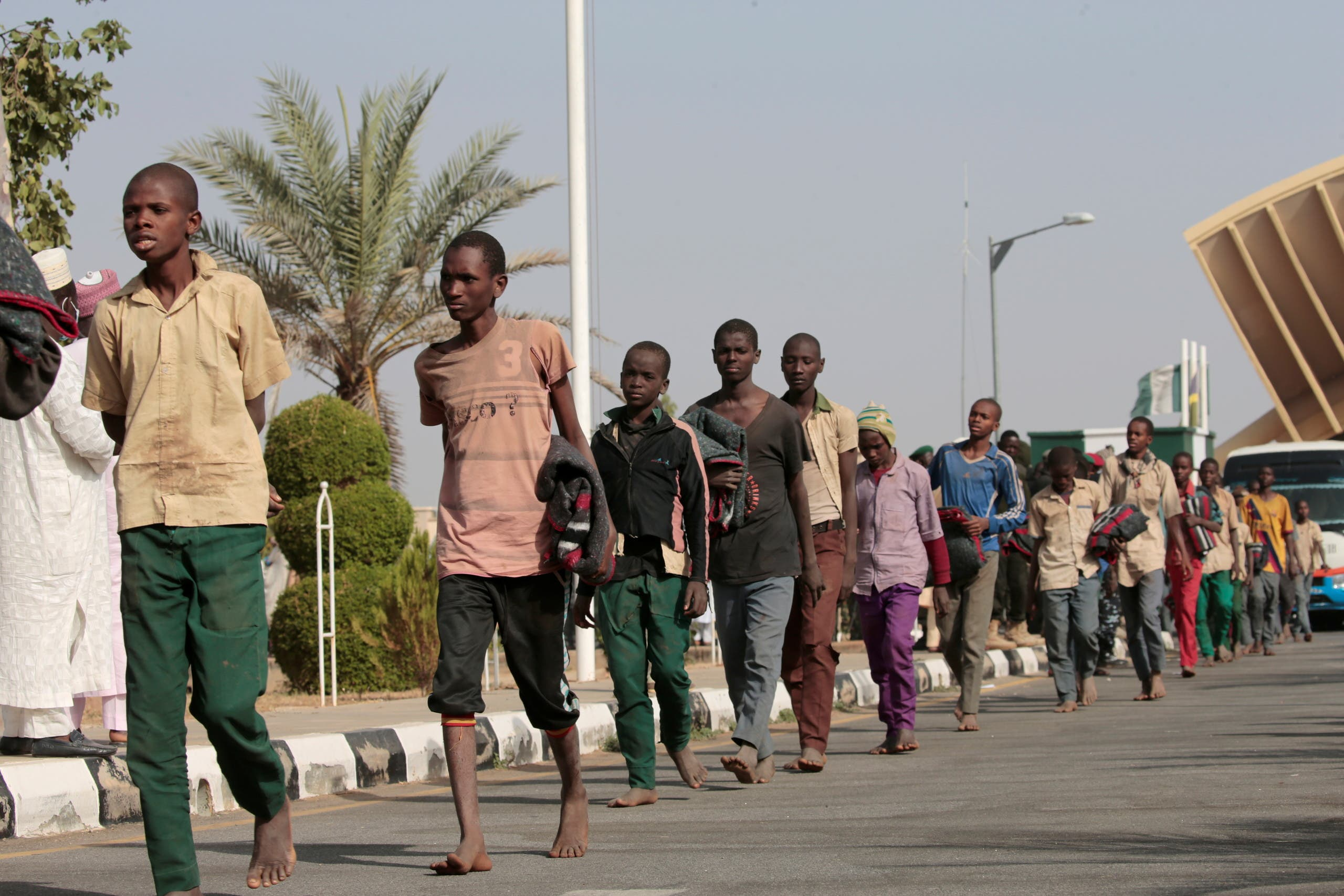 Freed Nigerian schoolboys walk after they were rescued by security forces in Katsina, Nigeria, on December 18, 2020. (Reuters)