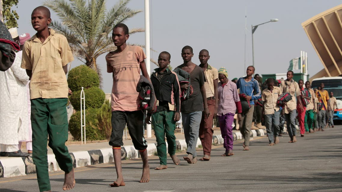 Freed Nigerian schoolboys walk after they were rescued by security forces in Katsina, Nigeria, December 18, 2020. (Reuters/Afolabi Sotunde)